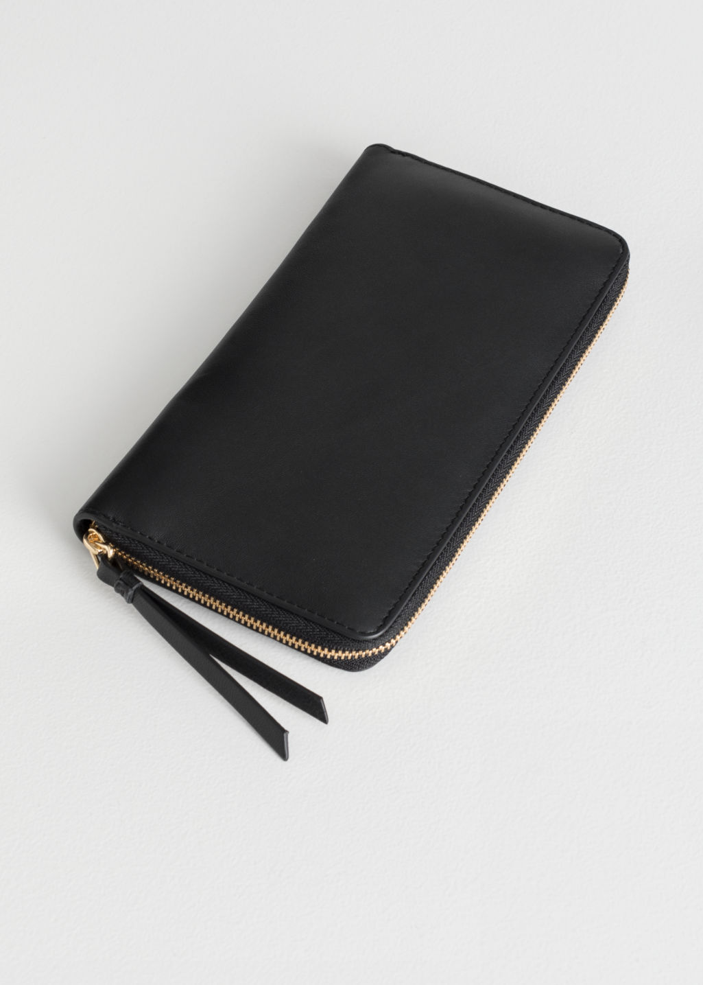 Front image of Stories large leather zip wallet in black