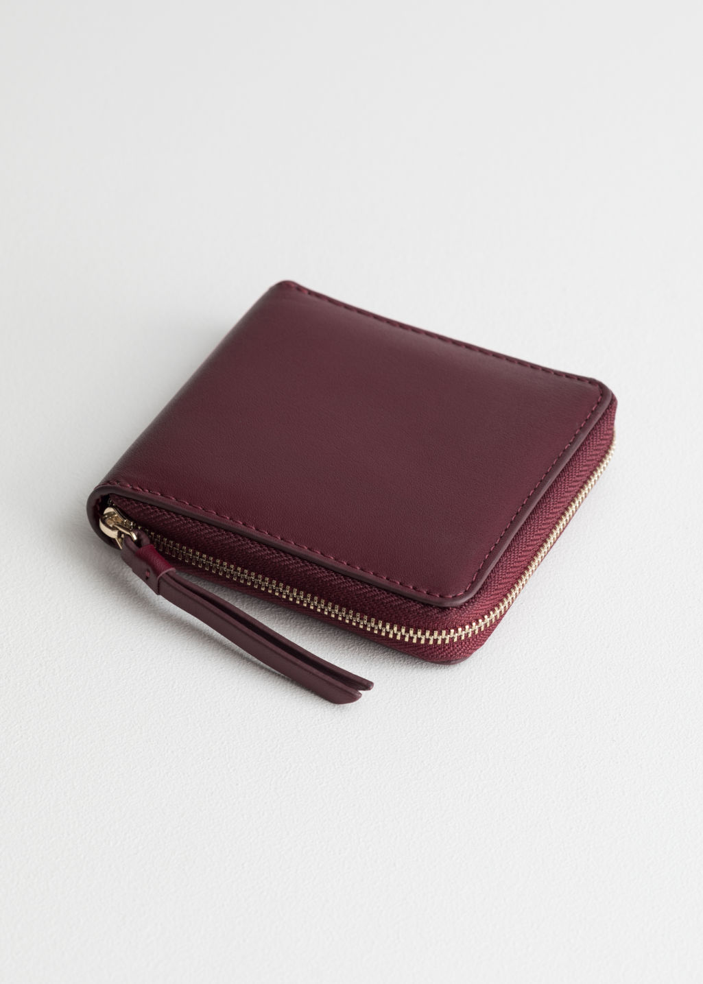 Front image of Stories leather zip wallet in red