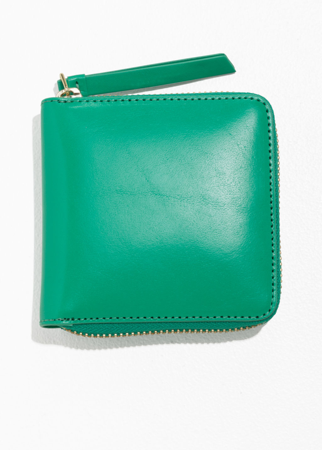 Front image of Stories leather zip wallet in green