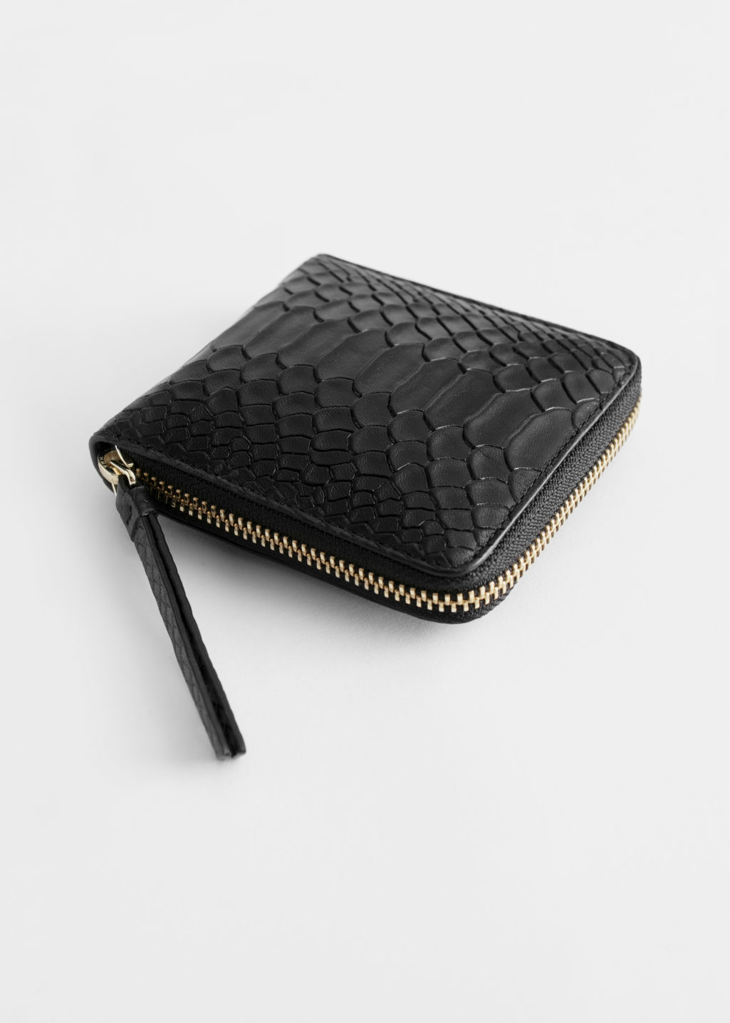 Front image of Stories leather zip wallet in black