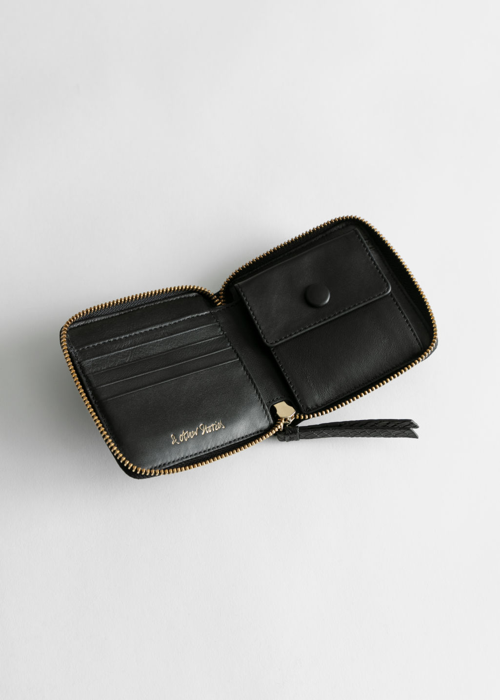 Back image of Stories leather zip wallet in black