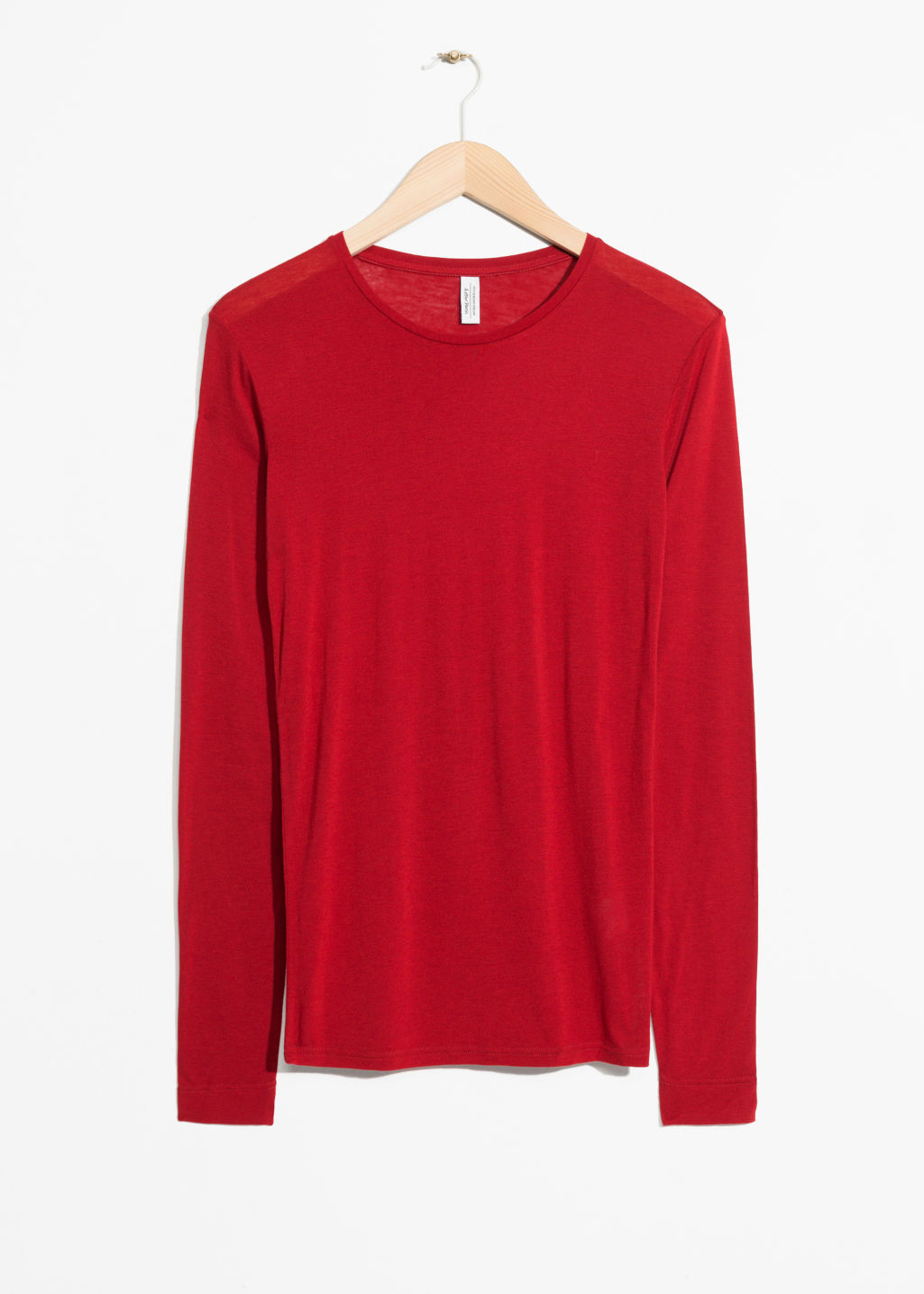 Front image of Stories longsleeve wool blend tee in red