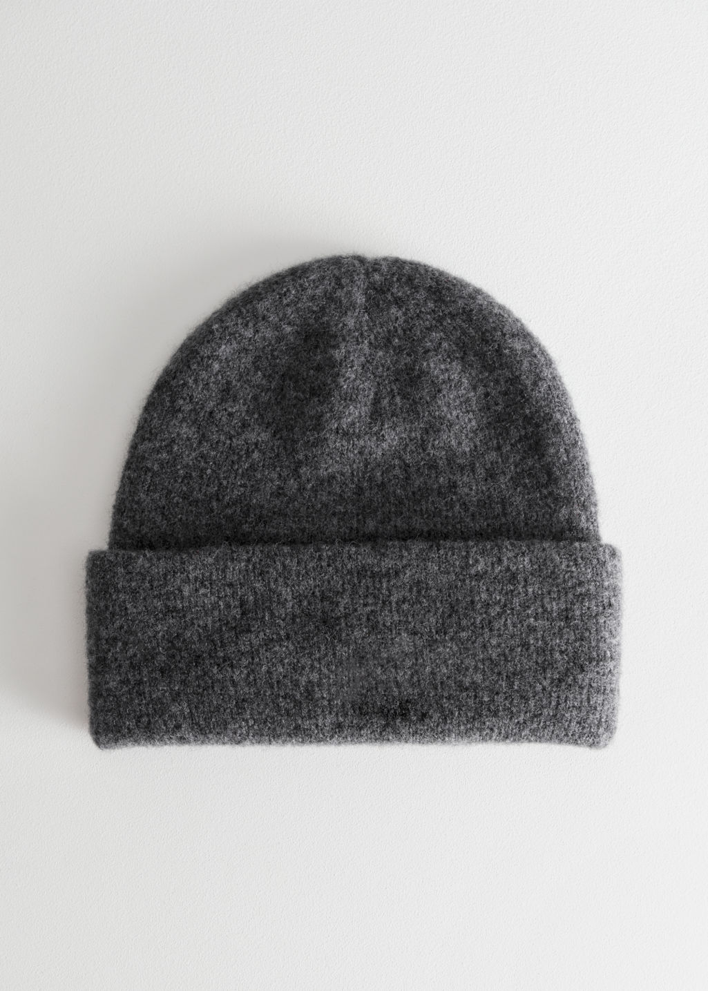 Front image of Stories merino wool beanie in grey