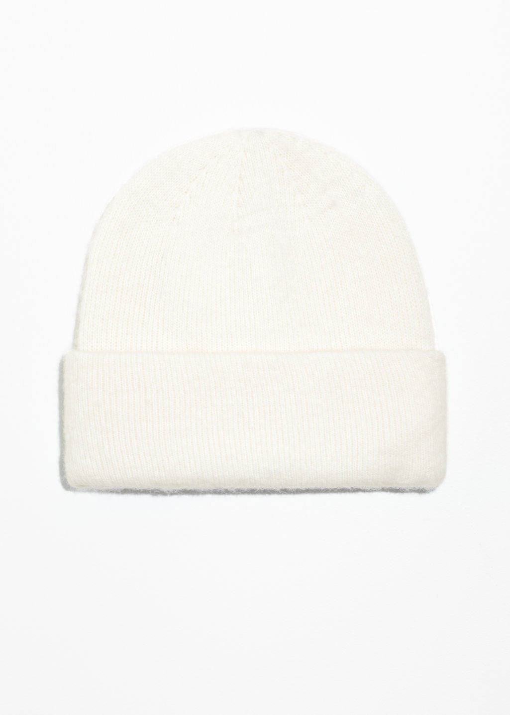 Front image of Stories merino wool beanie in white