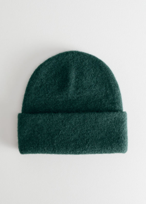 Front image of Stories merino wool beanie in turquoise