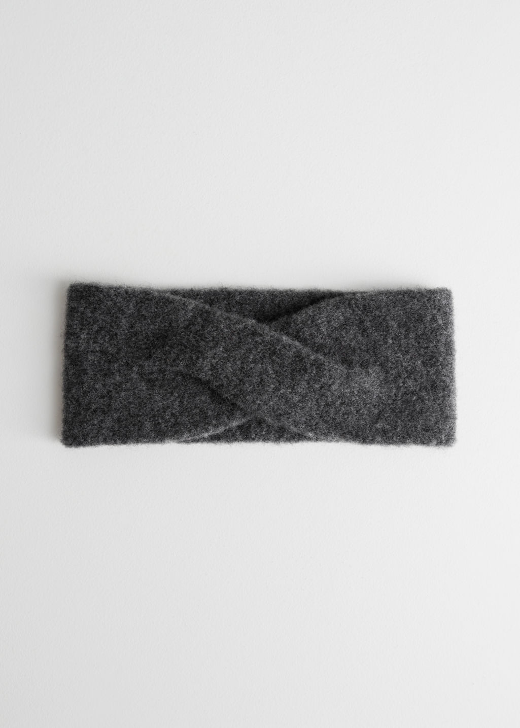 Front image of Stories merino wool headband in grey