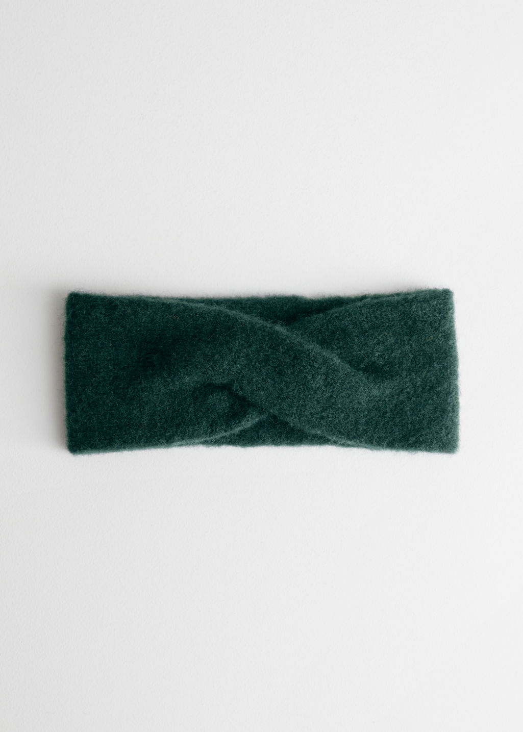 Front image of Stories merino wool headband in turquoise