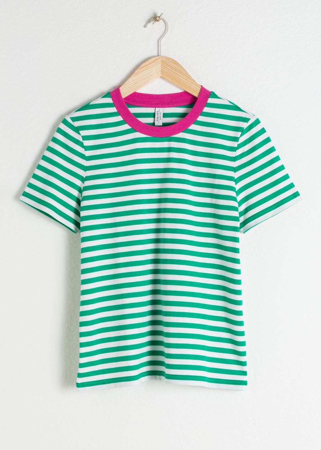 Front image of Stories striped tee in green