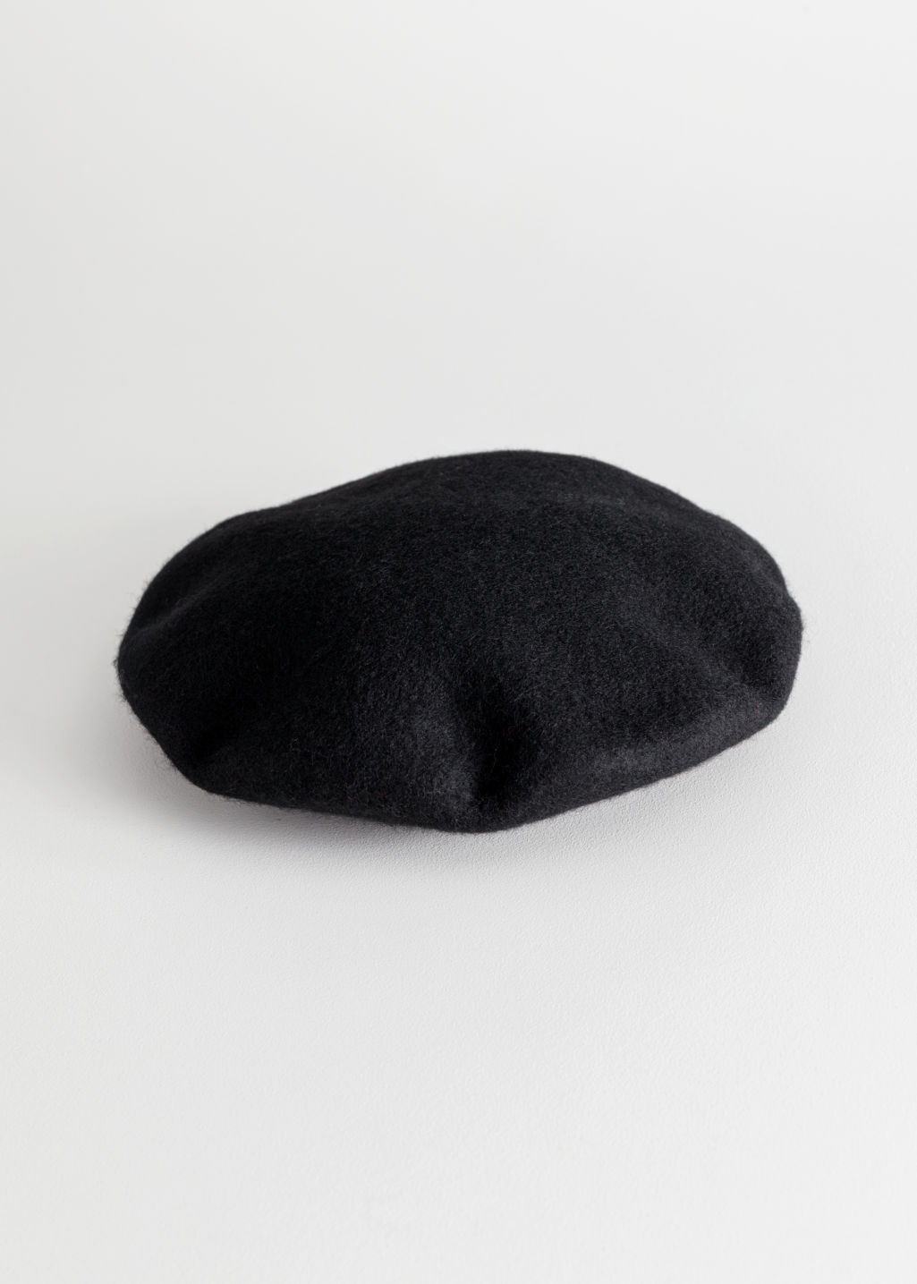 Front image of Stories wool beret in black ... 90d01f18335