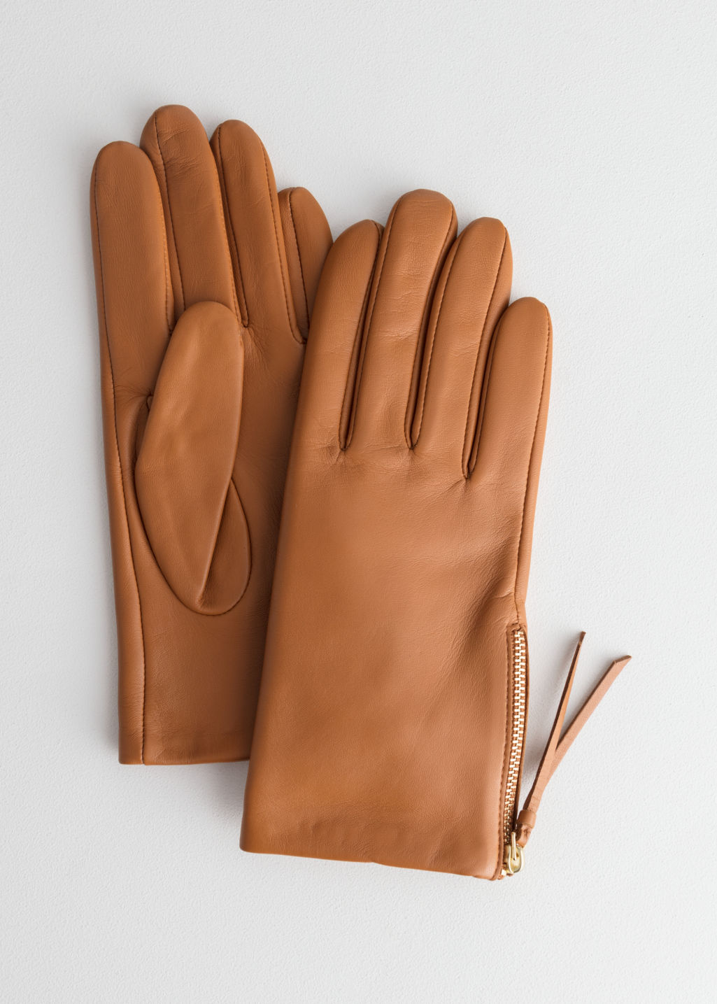 Front image of Stories side zip gloves in beige