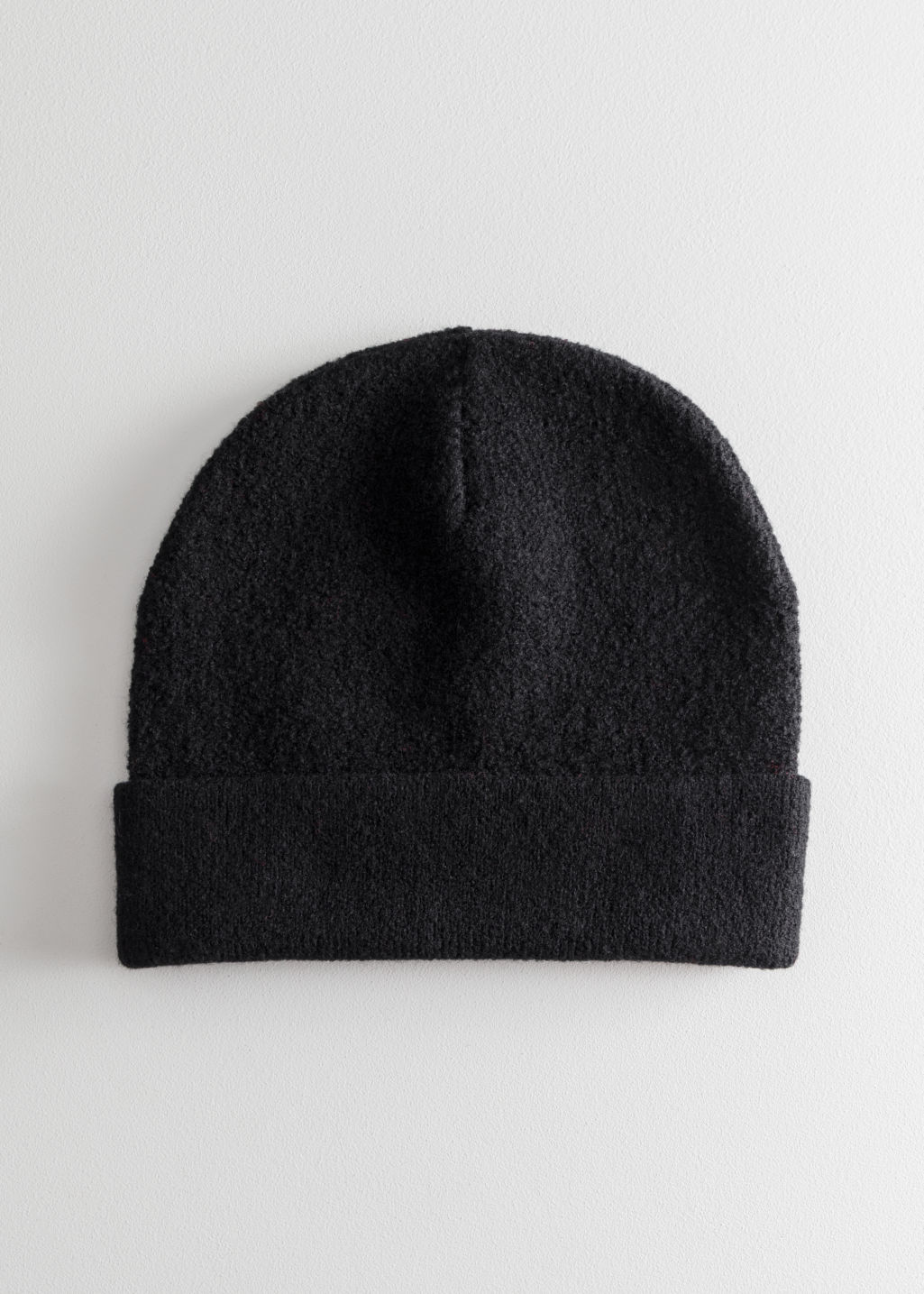 Front image of Stories wool beanie in black