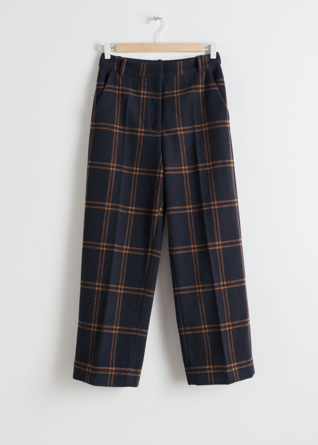 Front image of Stories cropped wool blend trousers in blue