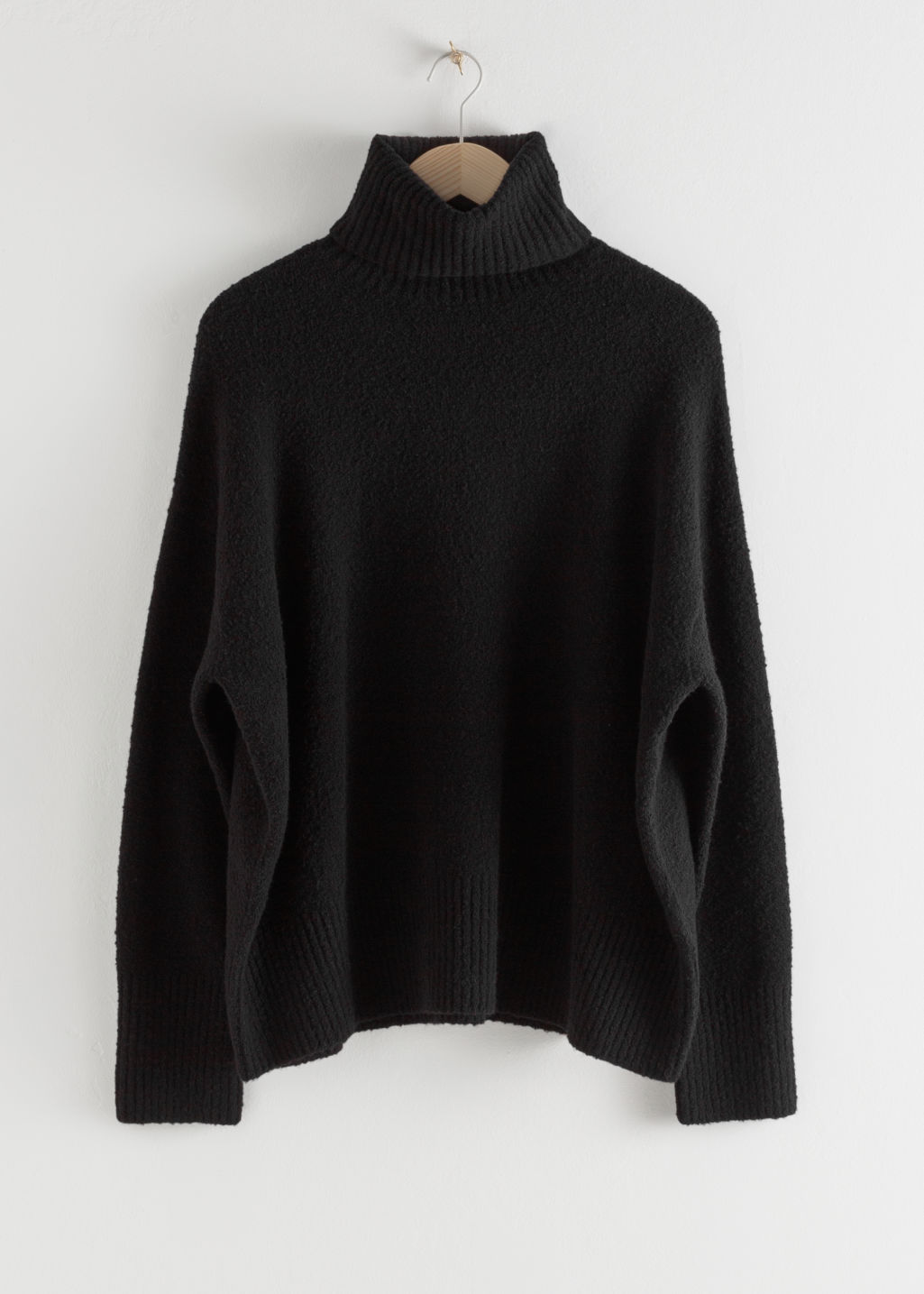 Front image of Stories high neck sweater in black