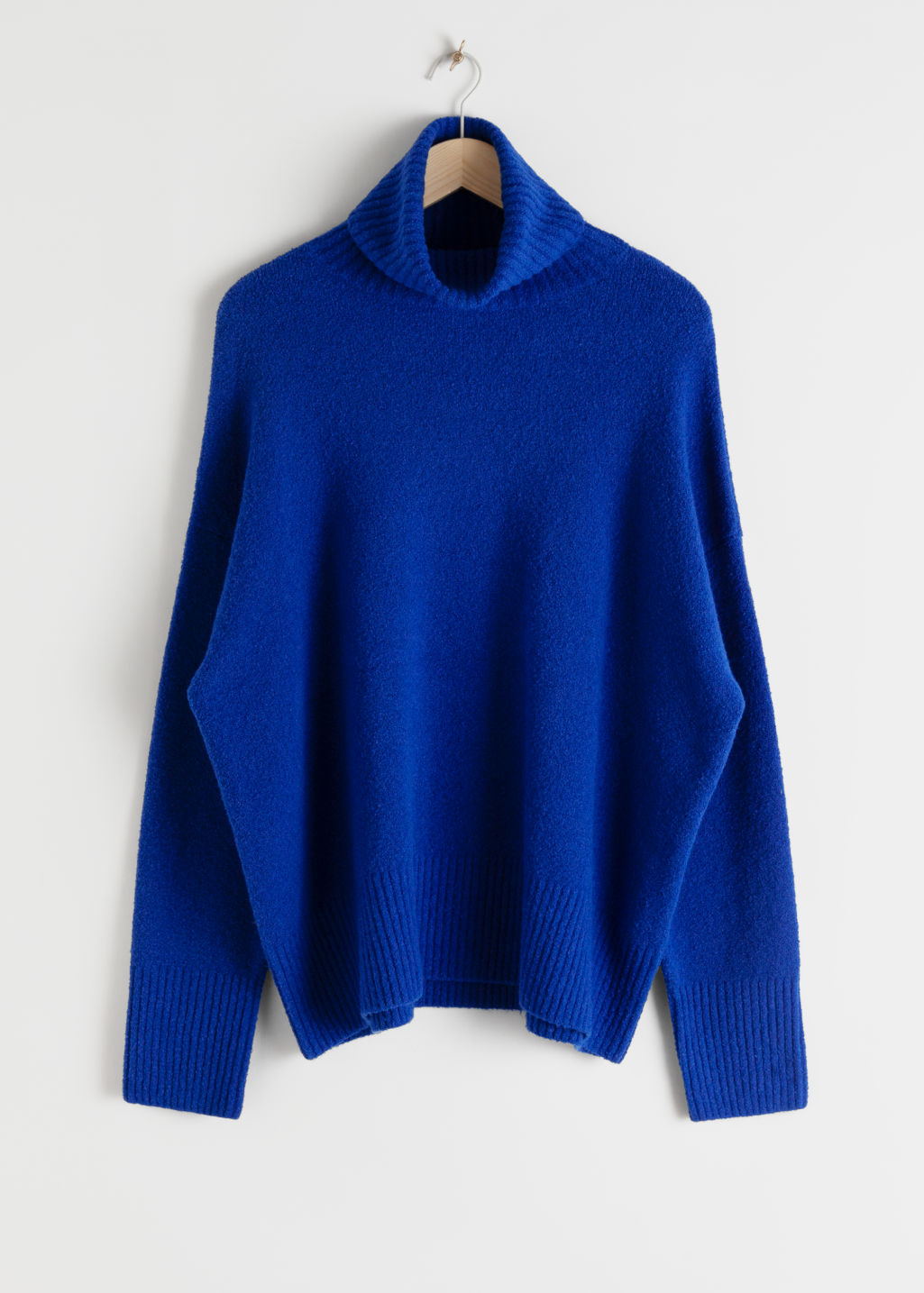 Front image of Stories high neck sweater in blue