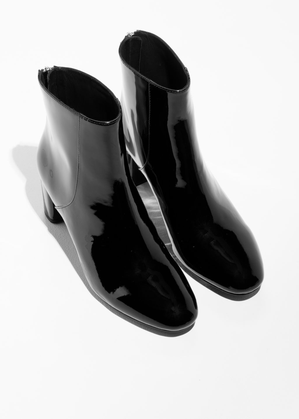 Back image of Stories patent leather zip boots in black