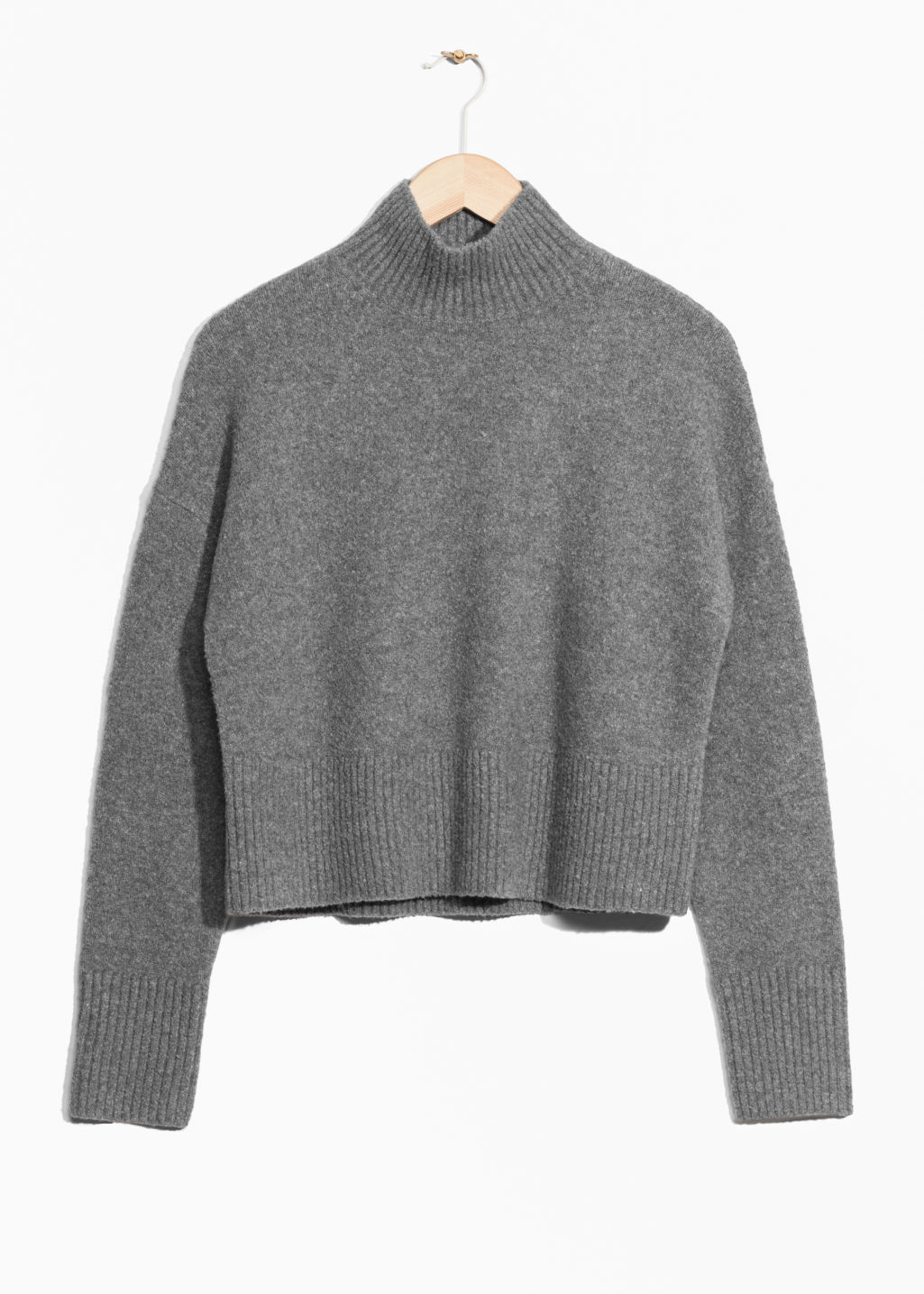 Front image of Stories crop sweater in grey