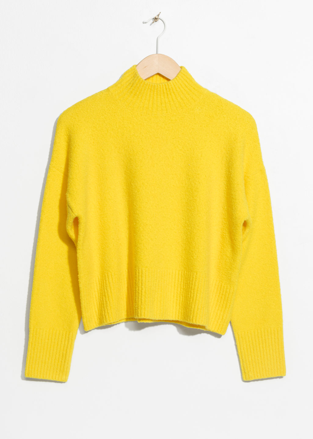 Front image of Stories crop sweater in yellow