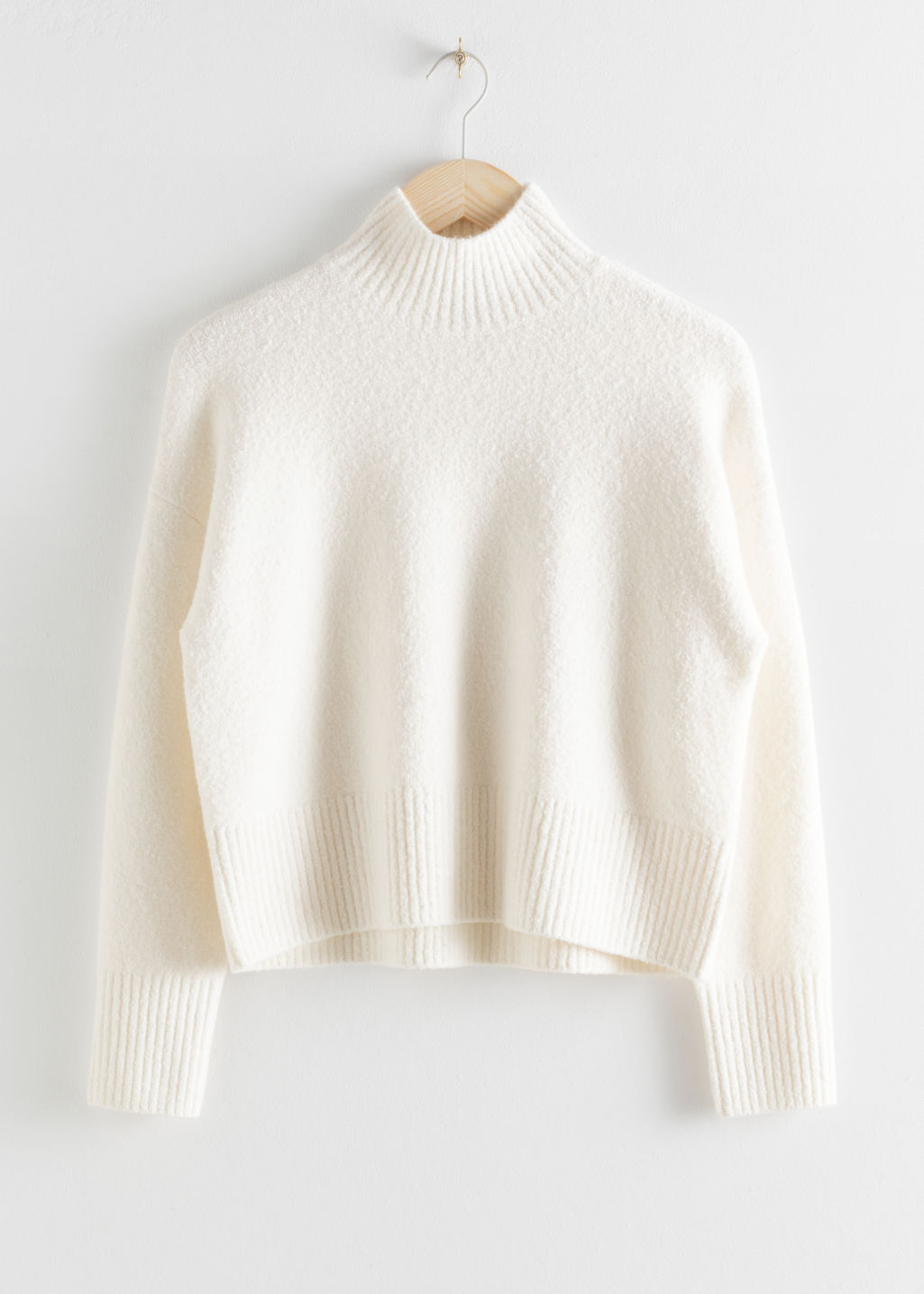 Front image of Stories cropped mock neck sweater in white
