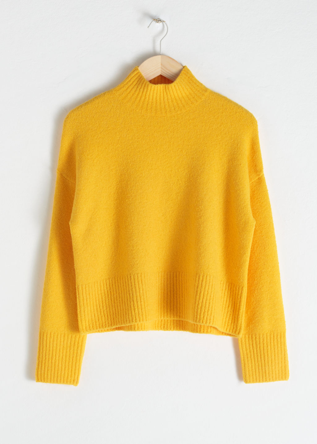 Front image of Stories cropped mock neck sweater in yellow