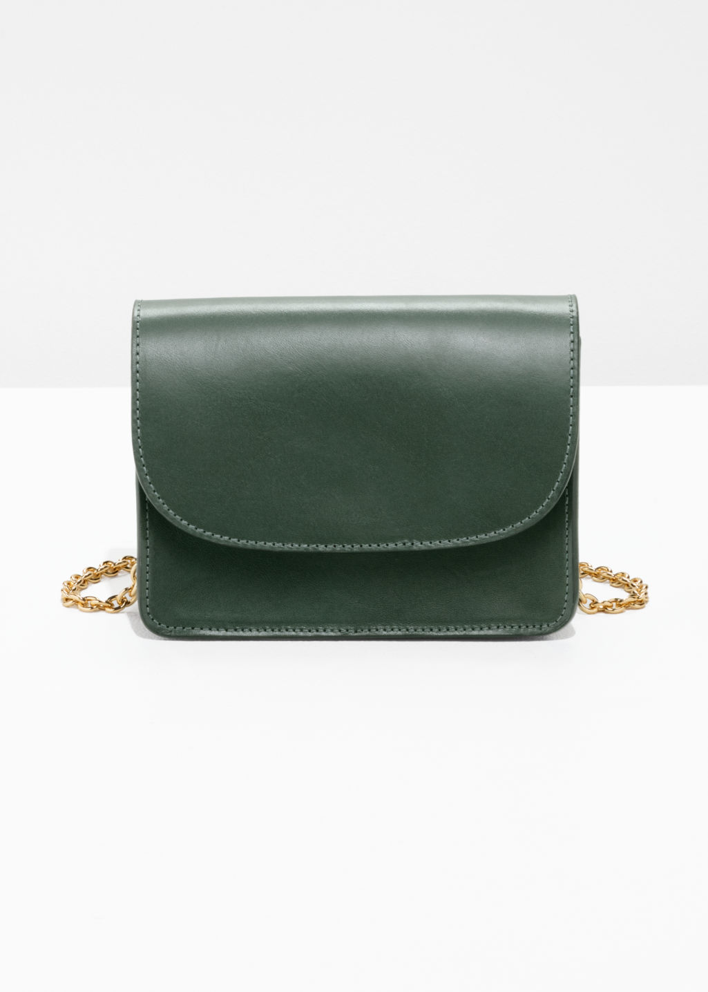 Front image of Stories golden chain flap bag in green
