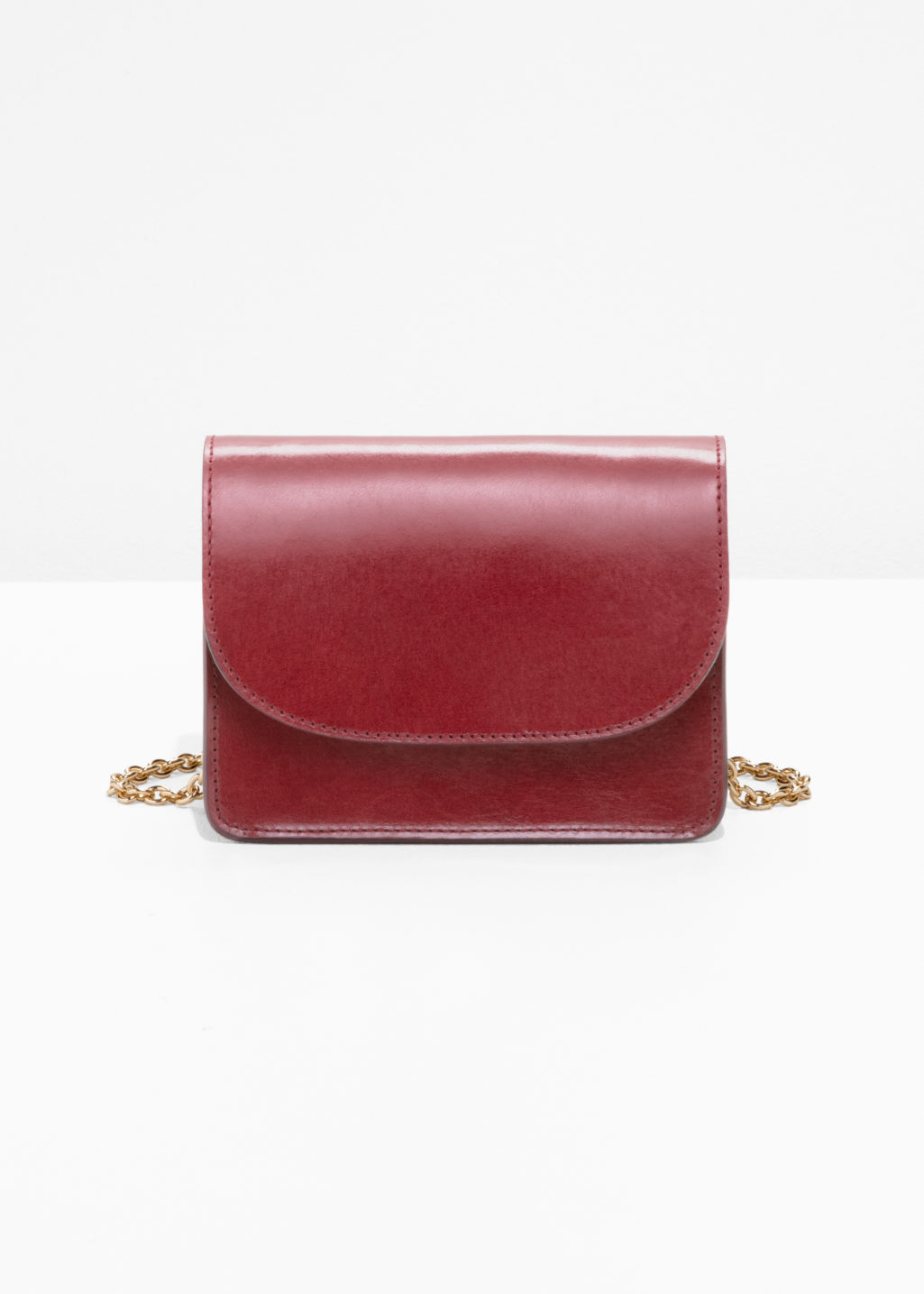 Front image of Stories golden chain flap bag in red