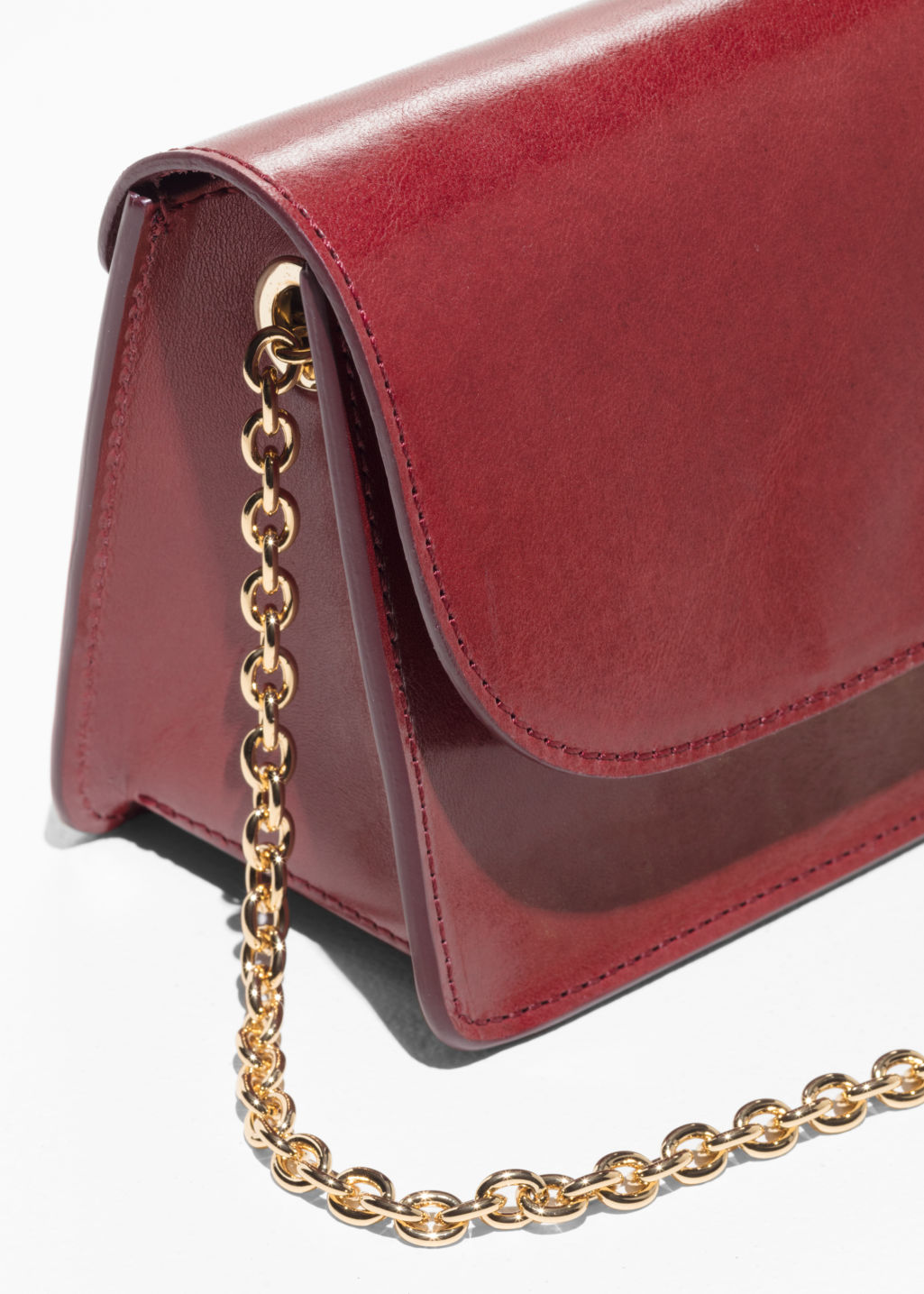 Back image of Stories golden chain flap bag in red