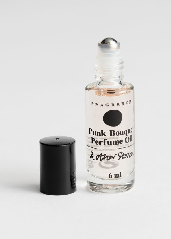 Front image of Stories roll on perfume in orange