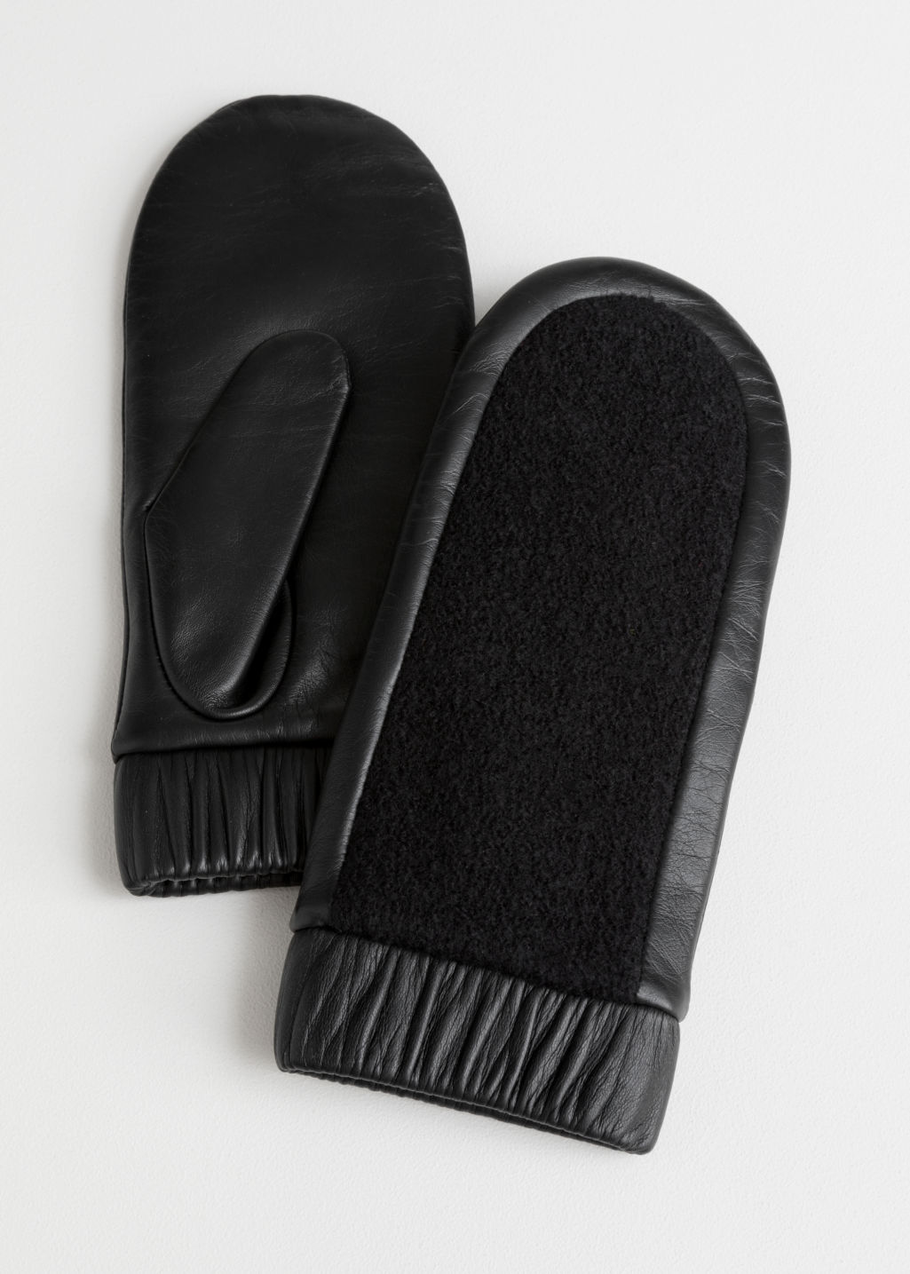 Front image of Stories leather mittens  in black