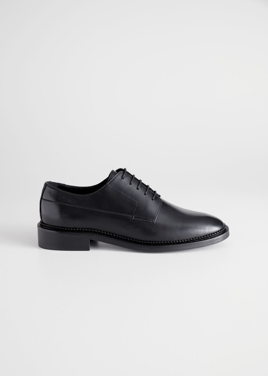 Front image of Stories leather oxfords in black