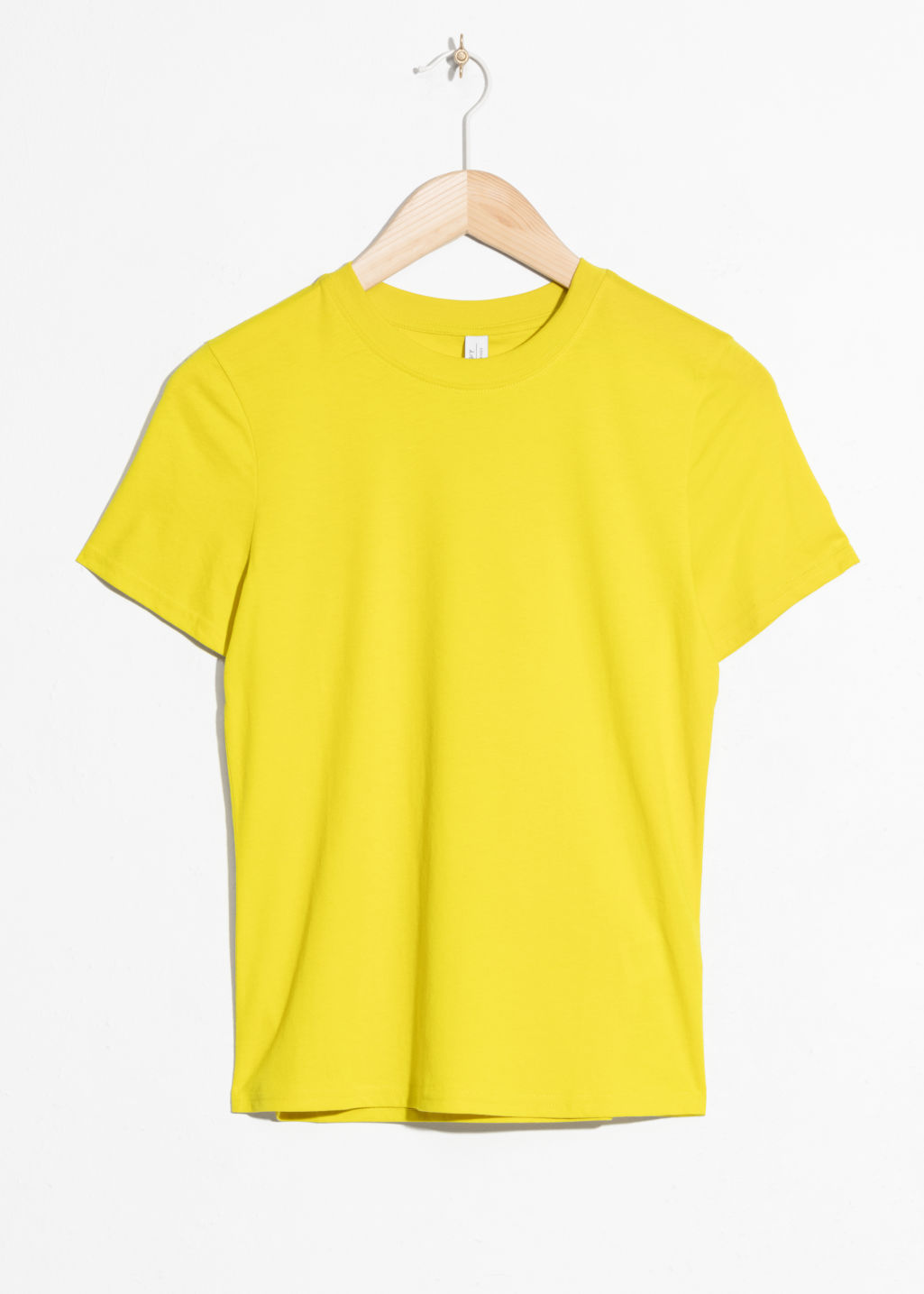 Front image of Stories cotton jersey t-shirt in yellow