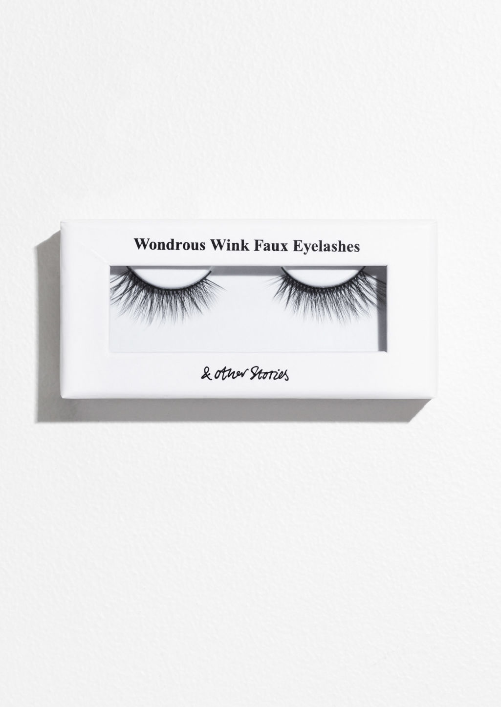 Front image of Stories faux eyelashes in grey