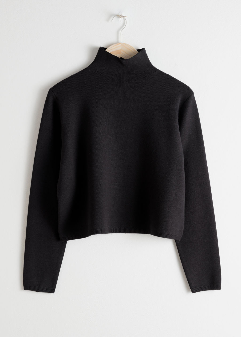 Front image of Stories tight turtleneck  in black