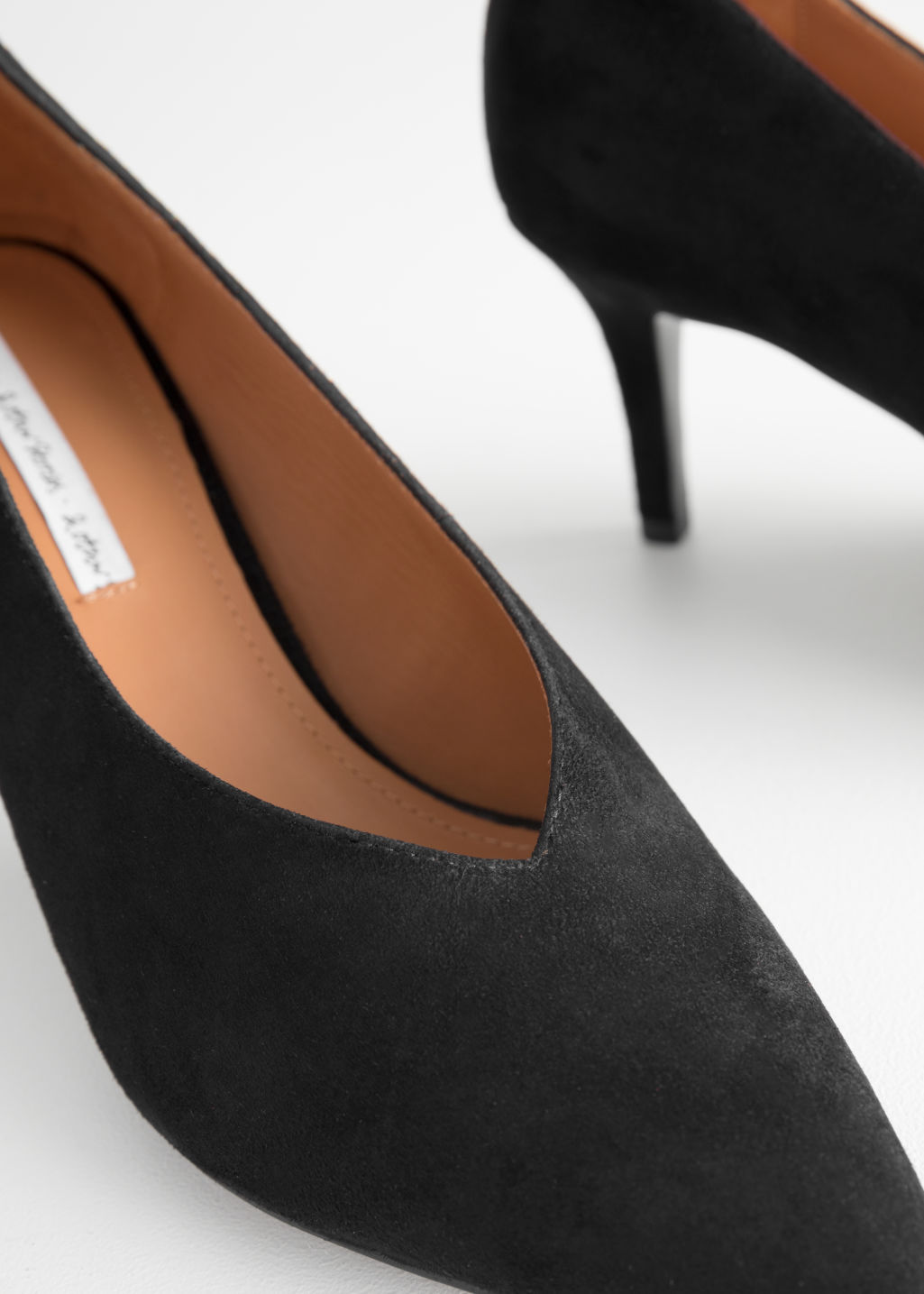 Back image of Stories pointed suede pump in black