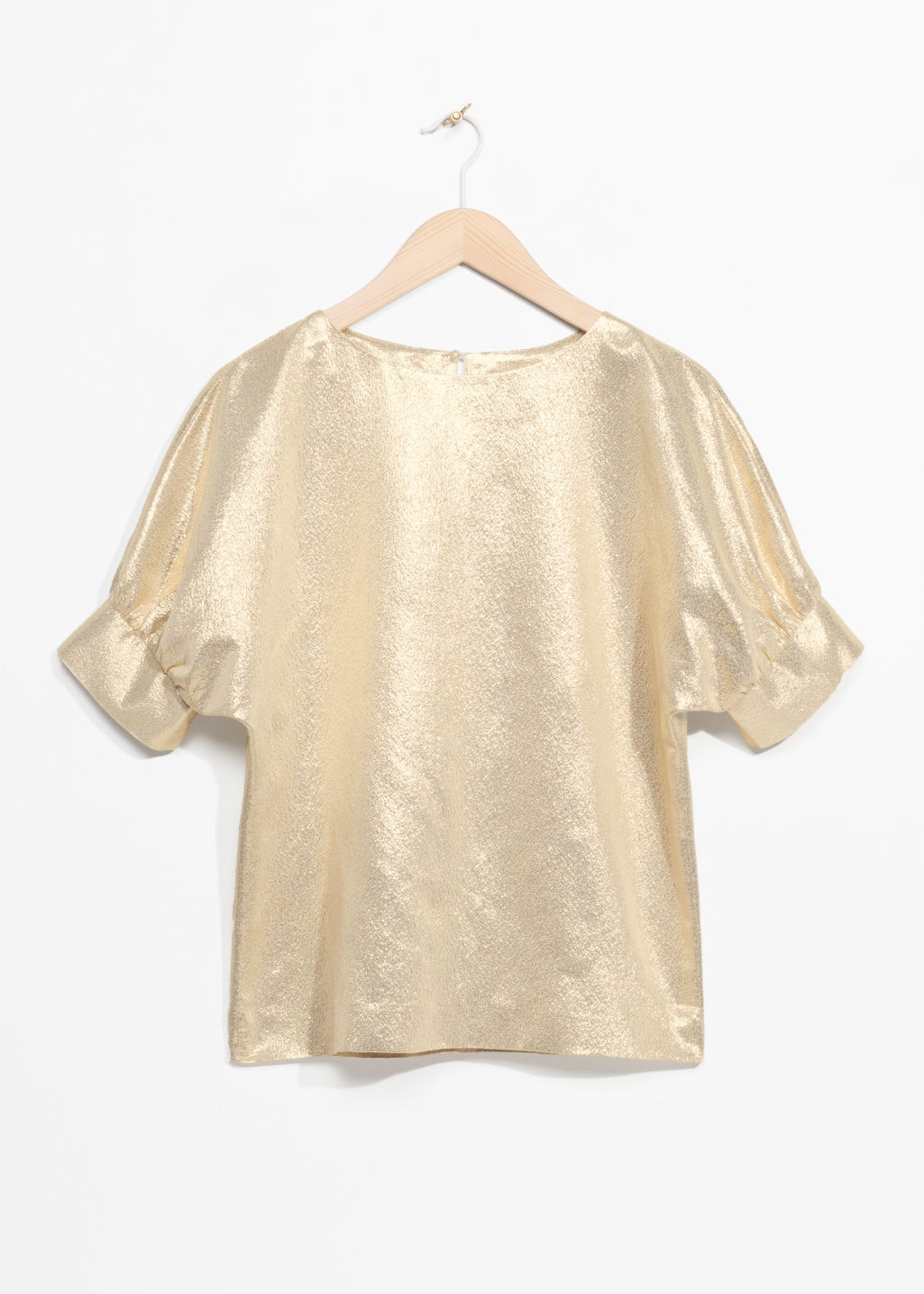 Front image of Stories metallic puff blouse in gold