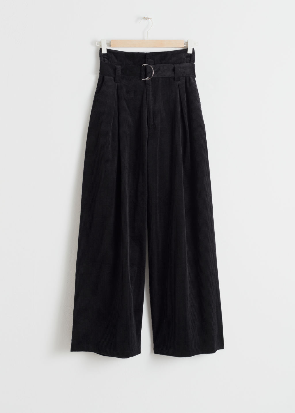 Front image of Stories wide corduroy trousers in black