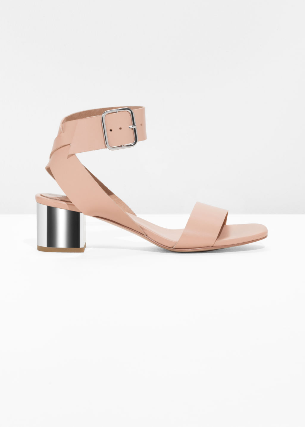 Front image of Stories mirrored heel leather sandals in orange