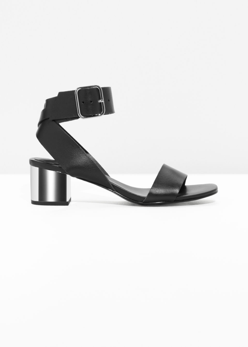Front image of Stories mirrored heel leather sandals in black