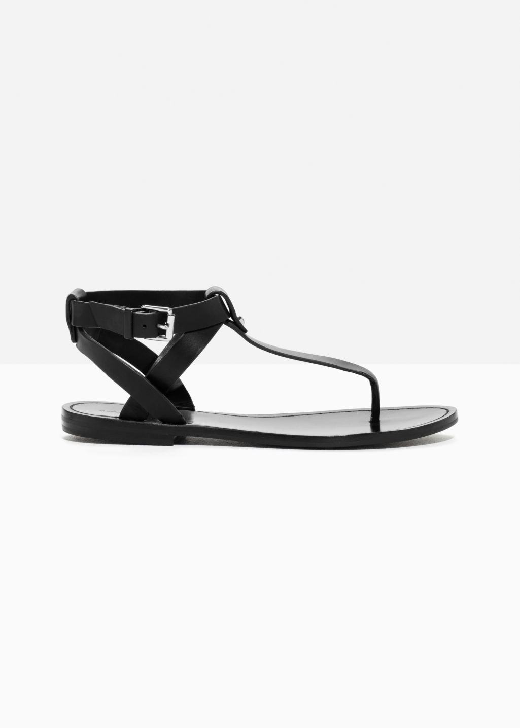 Front image of Stories suede thong sandal in black