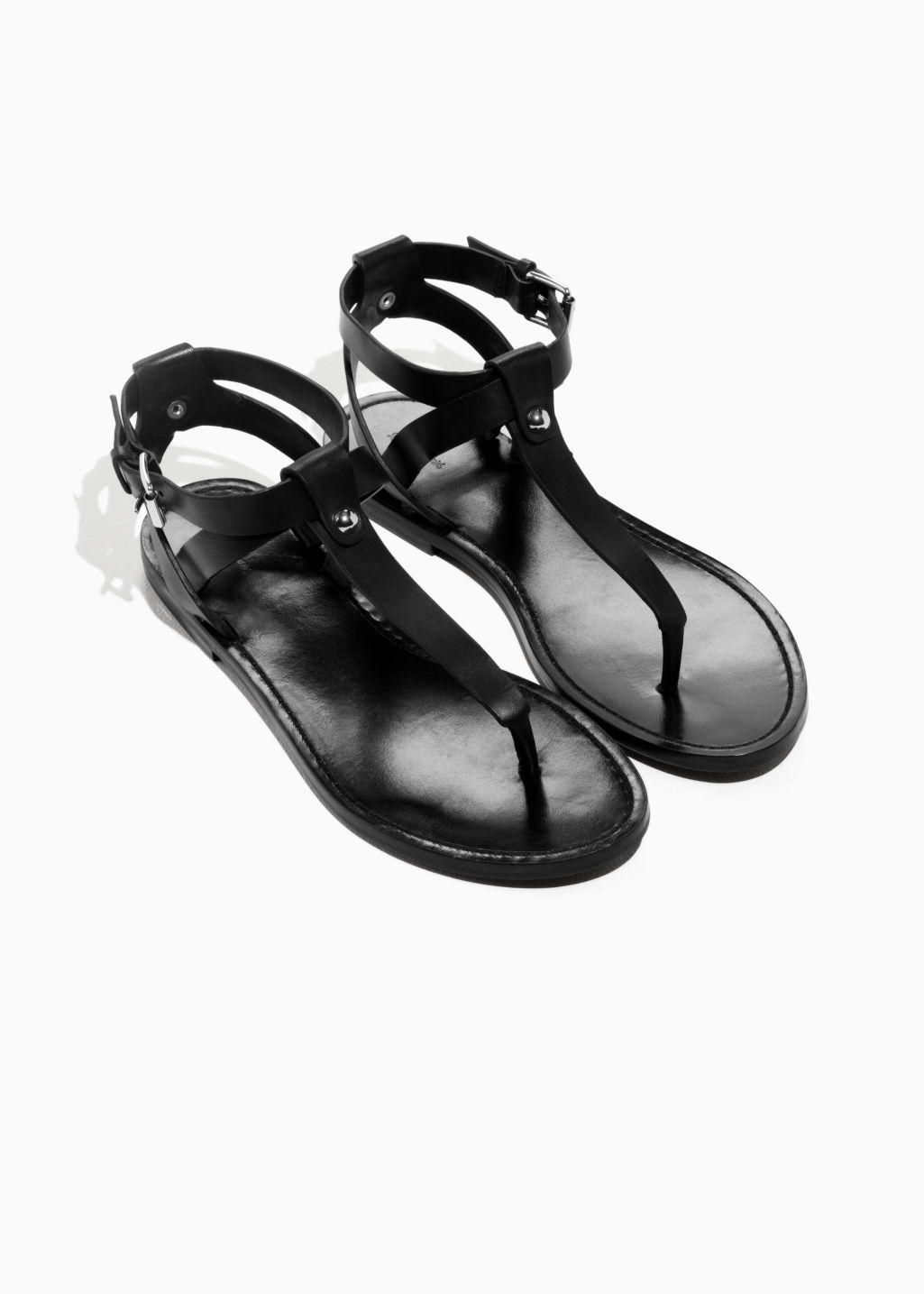 Back image of Stories suede thong sandal in black