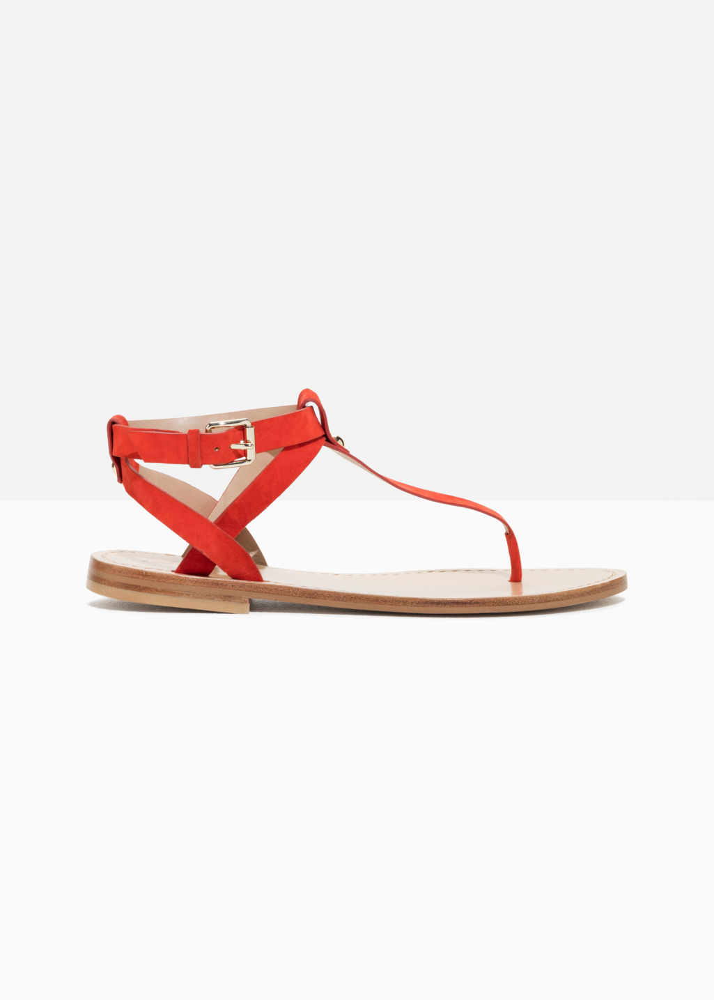Front image of Stories suede thong sandal in red