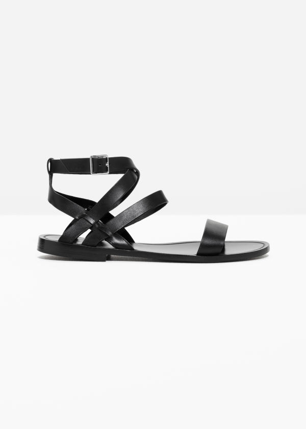 Front image of Stories raw edge leather sandal in black