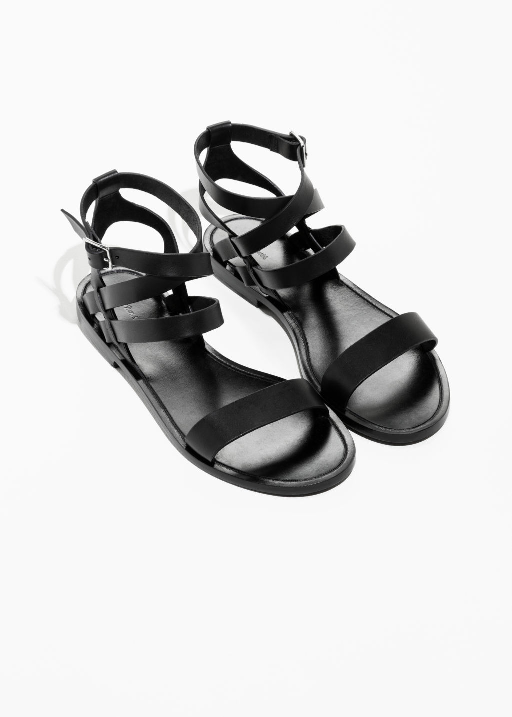 Back image of Stories raw edge leather sandal in black