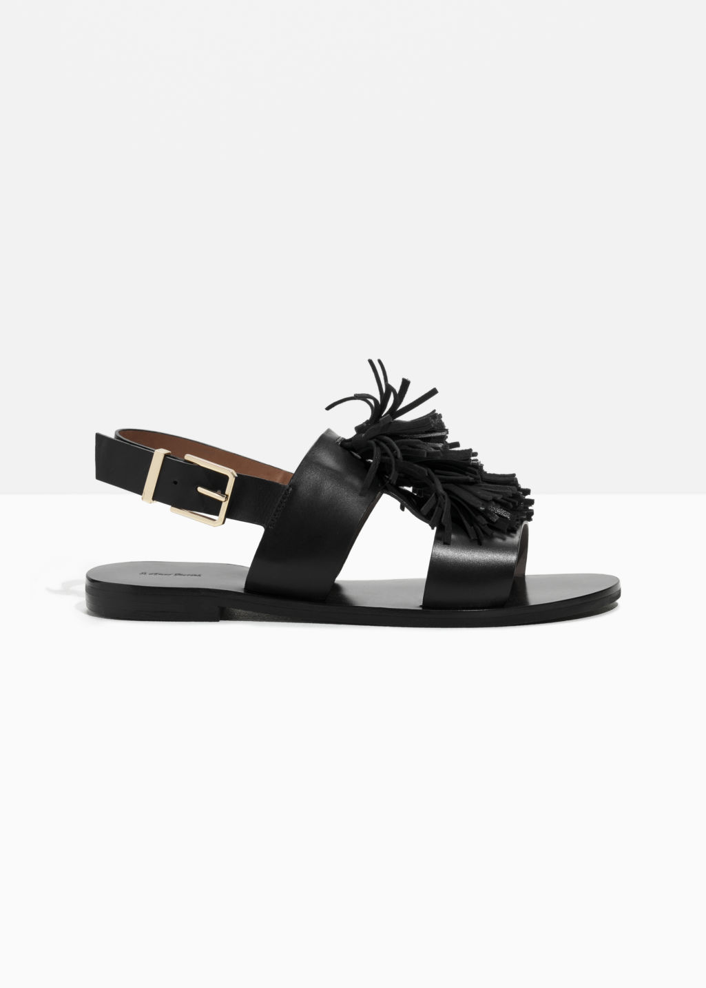 Front image of Stories suede tassel leather sandalette in black