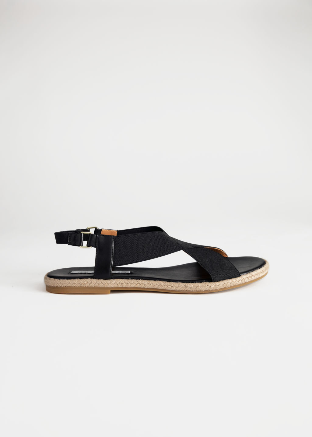 Front image of Stories cross strap sandal in black