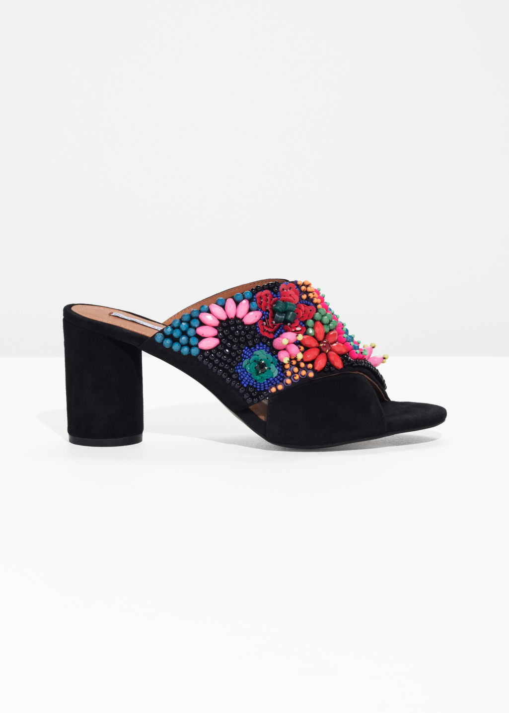 Front image of Stories suede cross strap mules in black
