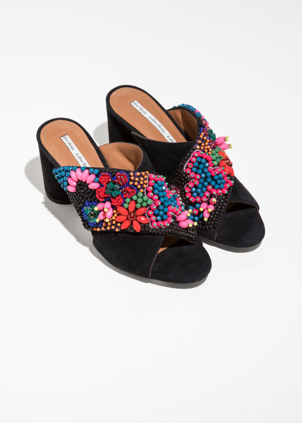 Back image of Stories suede cross strap mules in black