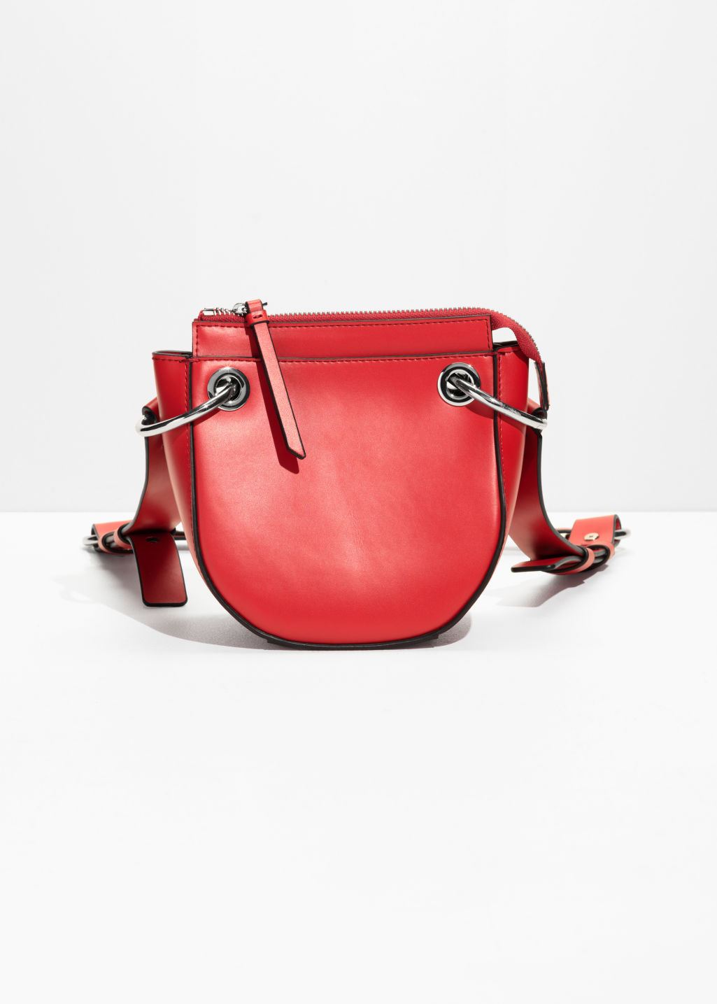 Front image of Stories mini leather saddle bag  in red