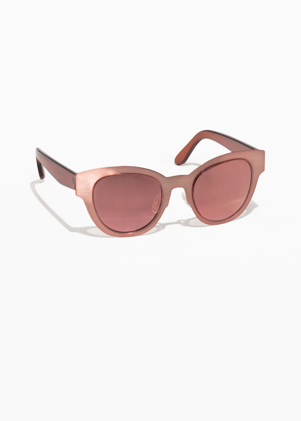 Front image of Stories black mirror glass shades  in pink