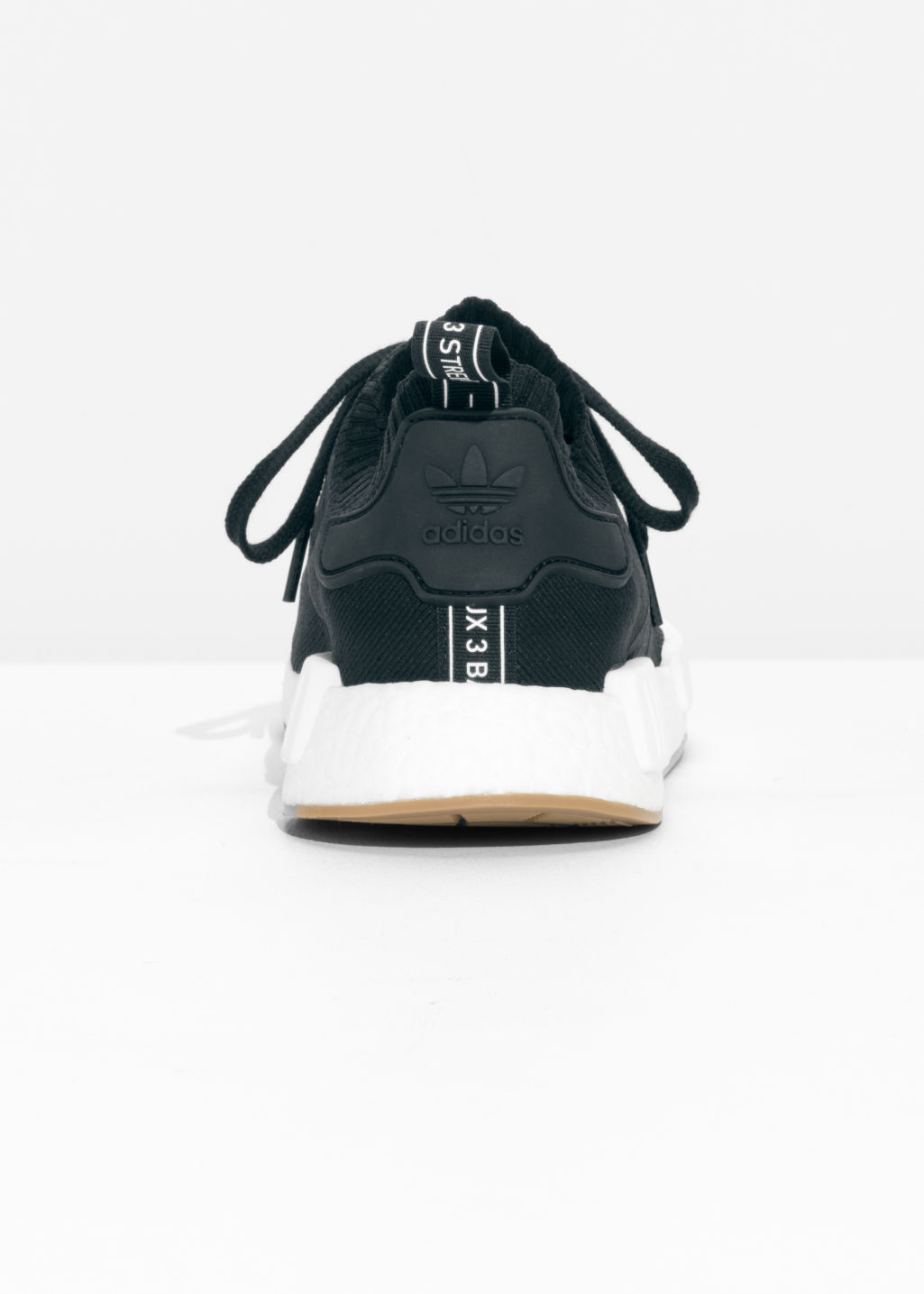 Back image of Stories adidas nmd  in black