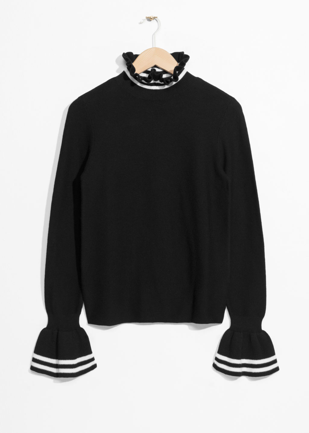 Front image of Stories flounce cuff sweater in black